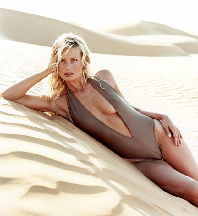 Daniela Pestova lying on sand in Pansea Camp, Tunisia in 2001