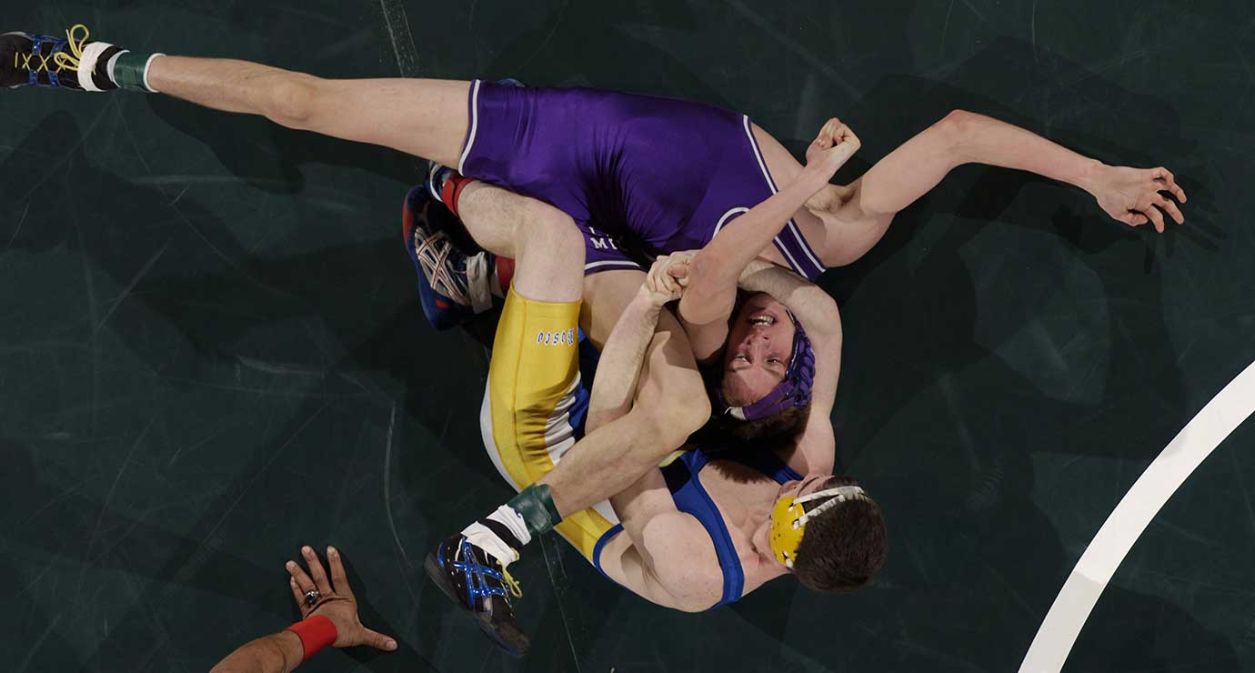 Gilbertville (Iowa) Don Bosco's Mack Reiter, top, has Lake Mills' Dan Helgeson in a choke-hold during the 2003 Class 1A, 125-pound championship match in Des Moines, Iowa.
