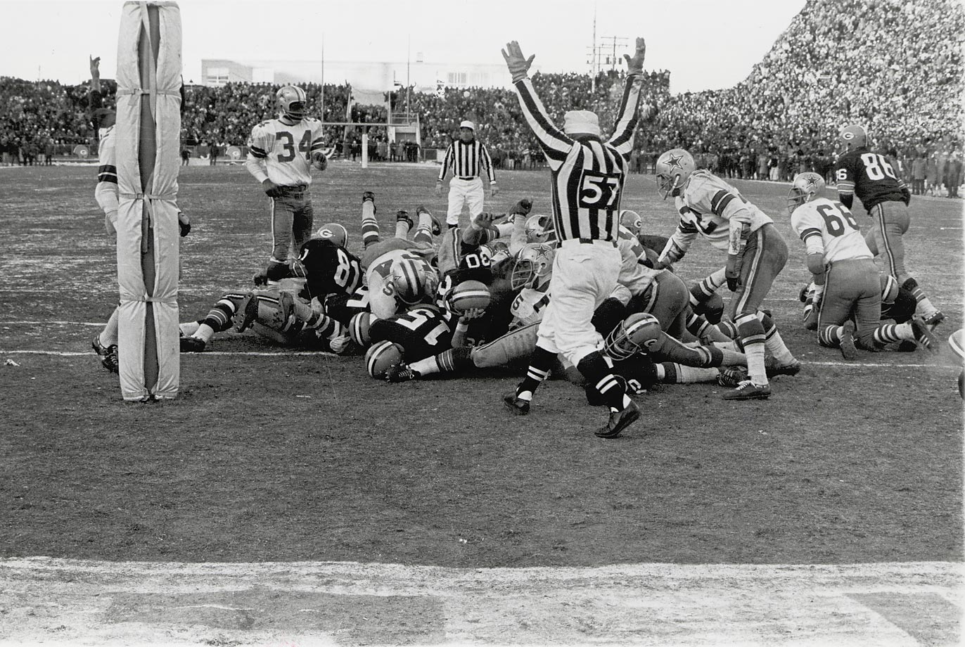 "As quarterback, Starr called all the team's plays, most famously a QB sneak in the Ice Bowl against the Cowboys. Starr called ""35 Wedge,"" but instead of handing the ball off to the halfback, Starr kept it himself. When Starr first suggested the play to Lombardi, the coach remarked, ""Well, run it, and let's get the hell out of here."" The Packers won, 21-17. (Text credit: Shannon Carroll)"