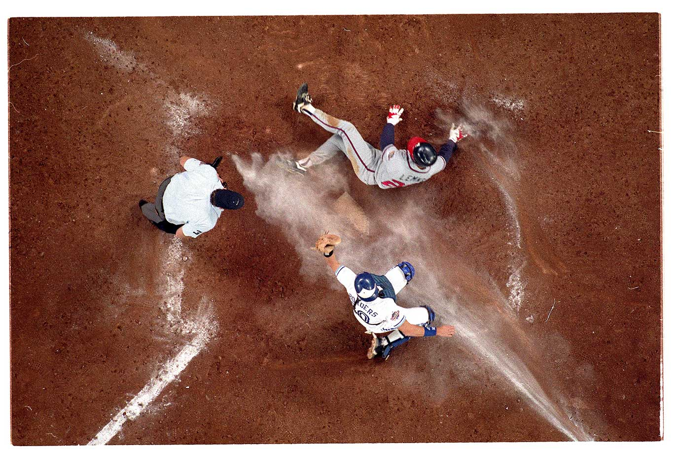 Toronto catcher Pat Borders making the tag at on Mark Lemke of the Atlanta Braves in Game 6 of the 1992 World Series.