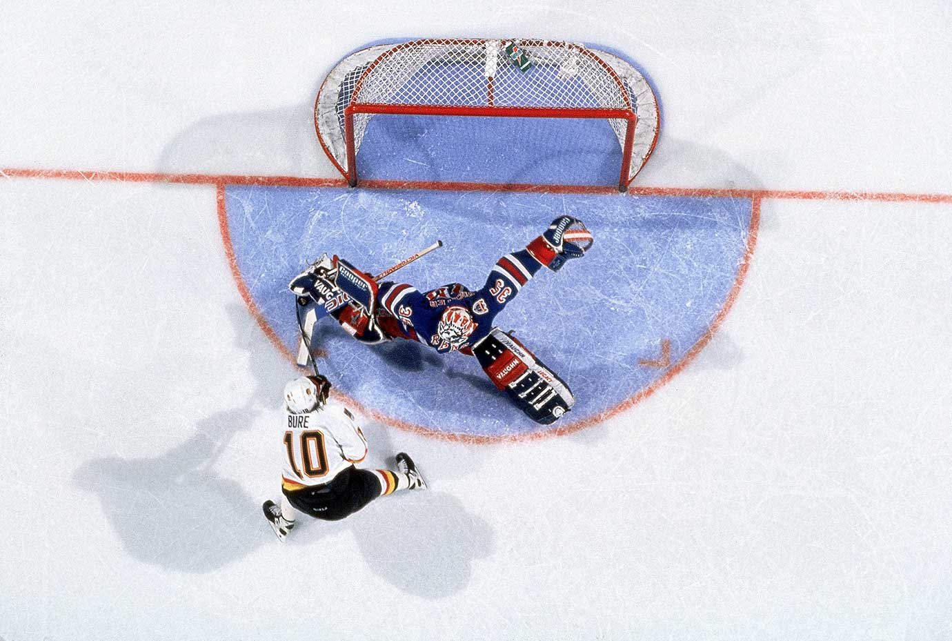 Pavel Bure of Vancouver in action vs New York Rangers goalie Mike Richter in the 1994 Stanley Cup Finals.