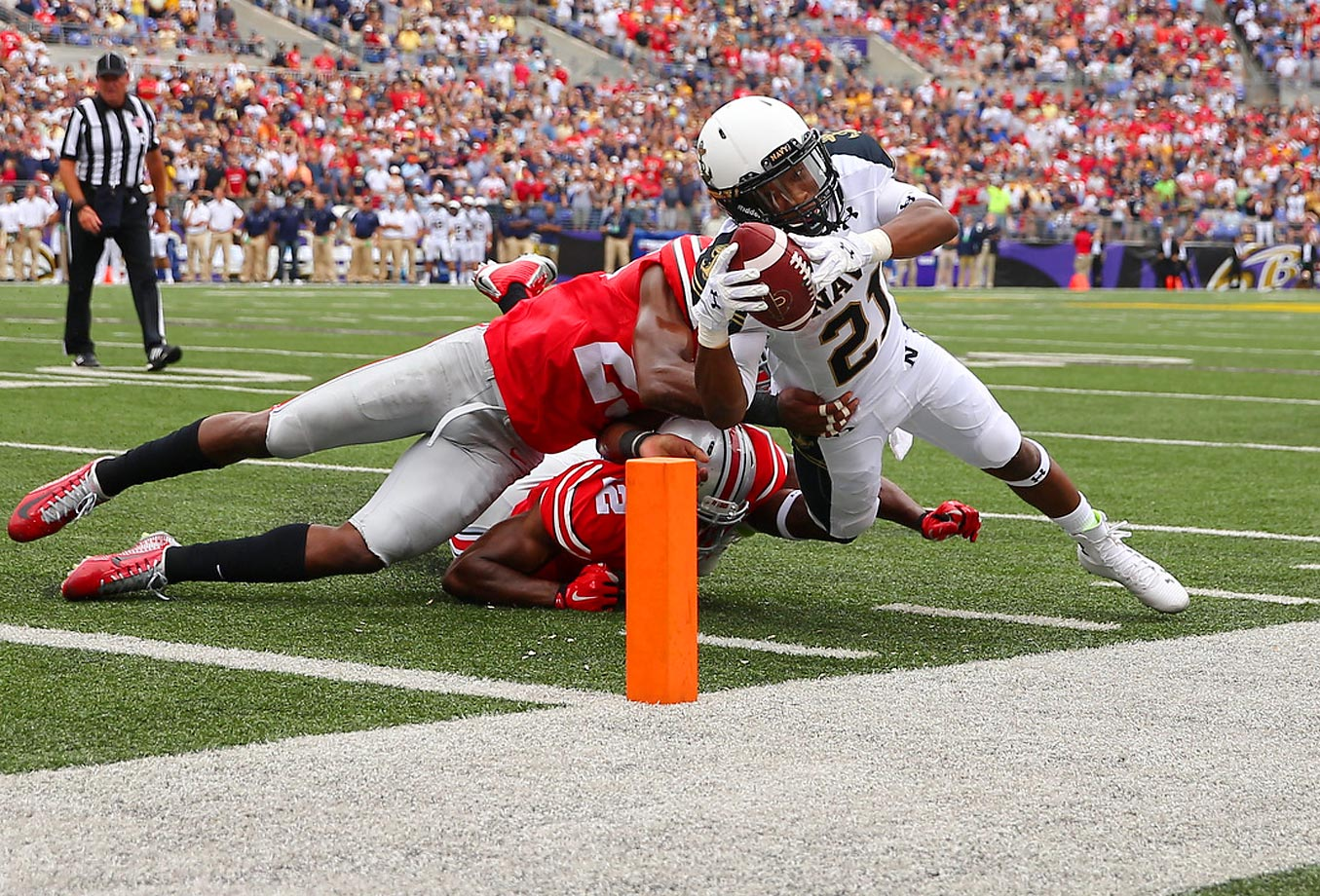 DeBrandon Sanders of Navy scores a 1-yard rushing touchdown against Doran Grant (12) and Tyvis Powell of the Ohio State Buckeyes.