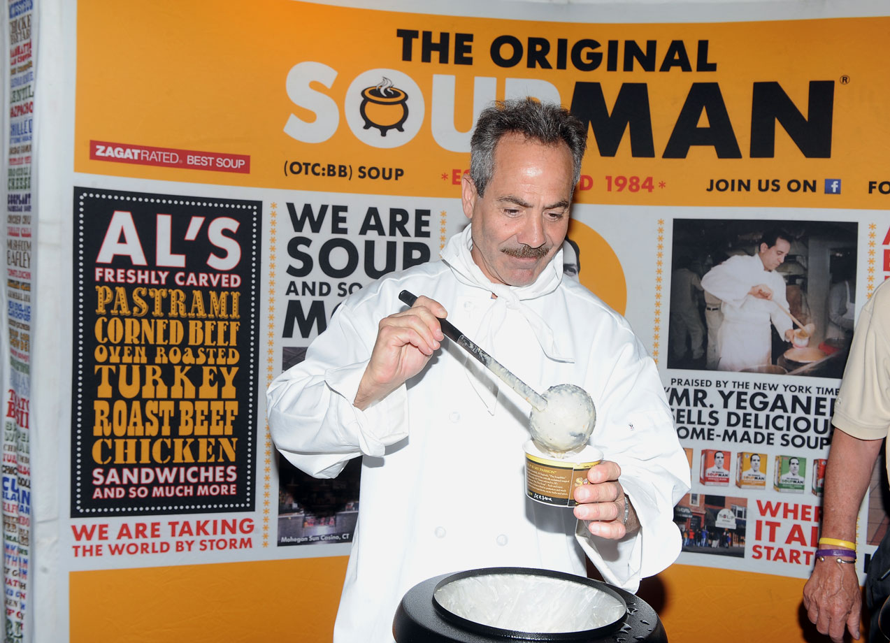 The Soup Nazi, Larry Thomas, greets customers.