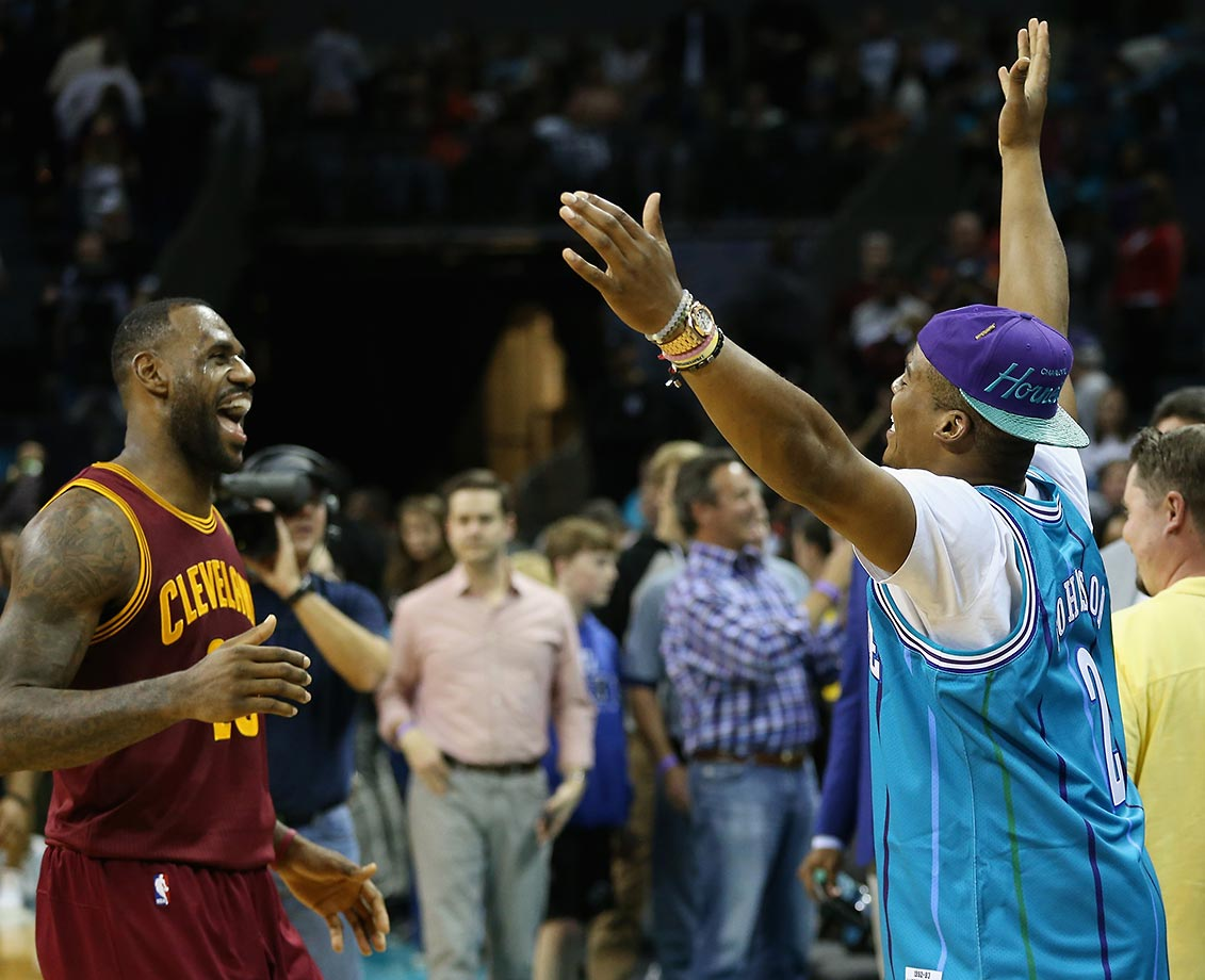 Cam Newton greets LeBron James after the Cleveland Cavaliers defeated the Charlotte Hornets 95-90 at Time Warner Cable Arena in North Carolina.                                                              Text credit: Daniel Hersh