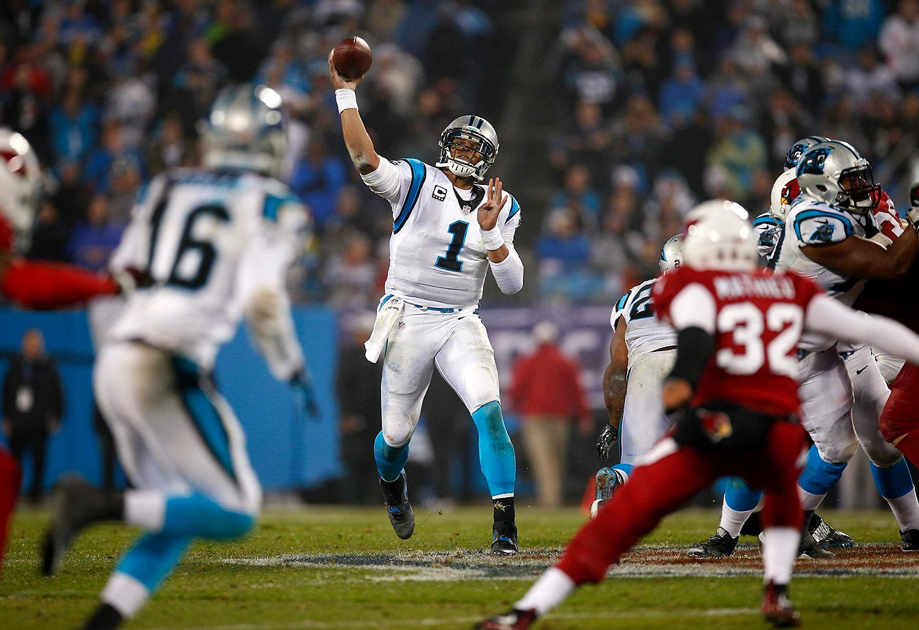 Cam Newton throws a pass in the wild card round of the 2014 NFL playoffs against the Arizona Cardinals. The Panthers won 27-16 as Newton threw for two touchdowns and one interception and added 35 rushing yards.                                                               Text credit: Daniel Hersh