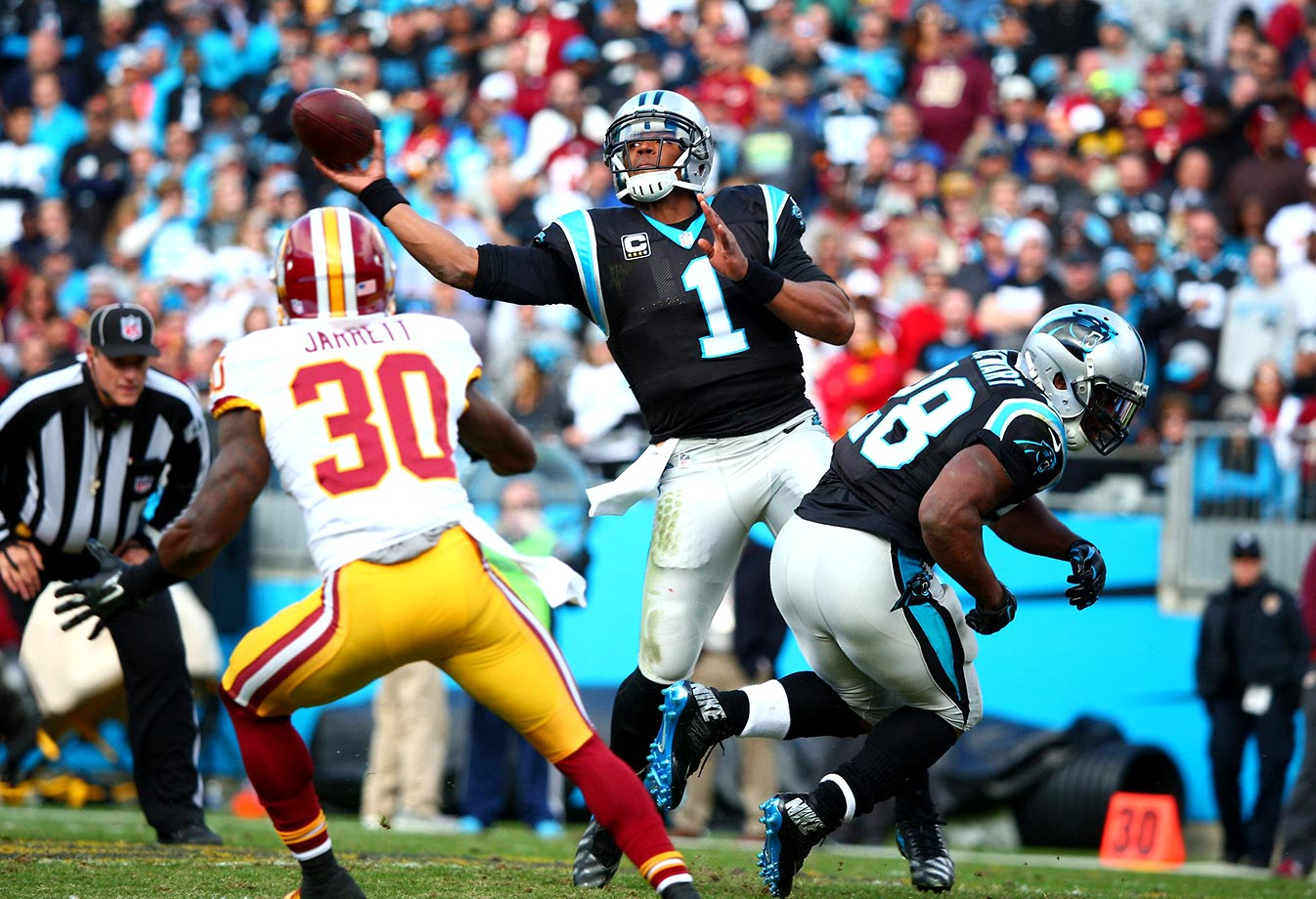 Cam Newton throws a pass against the Washington Redskins during a November 2015 game at Bank of America Stadium in Charlotte. His five touchdown passes helped the Panthers win 44-16.                                                              Text credit: Daniel Hersh