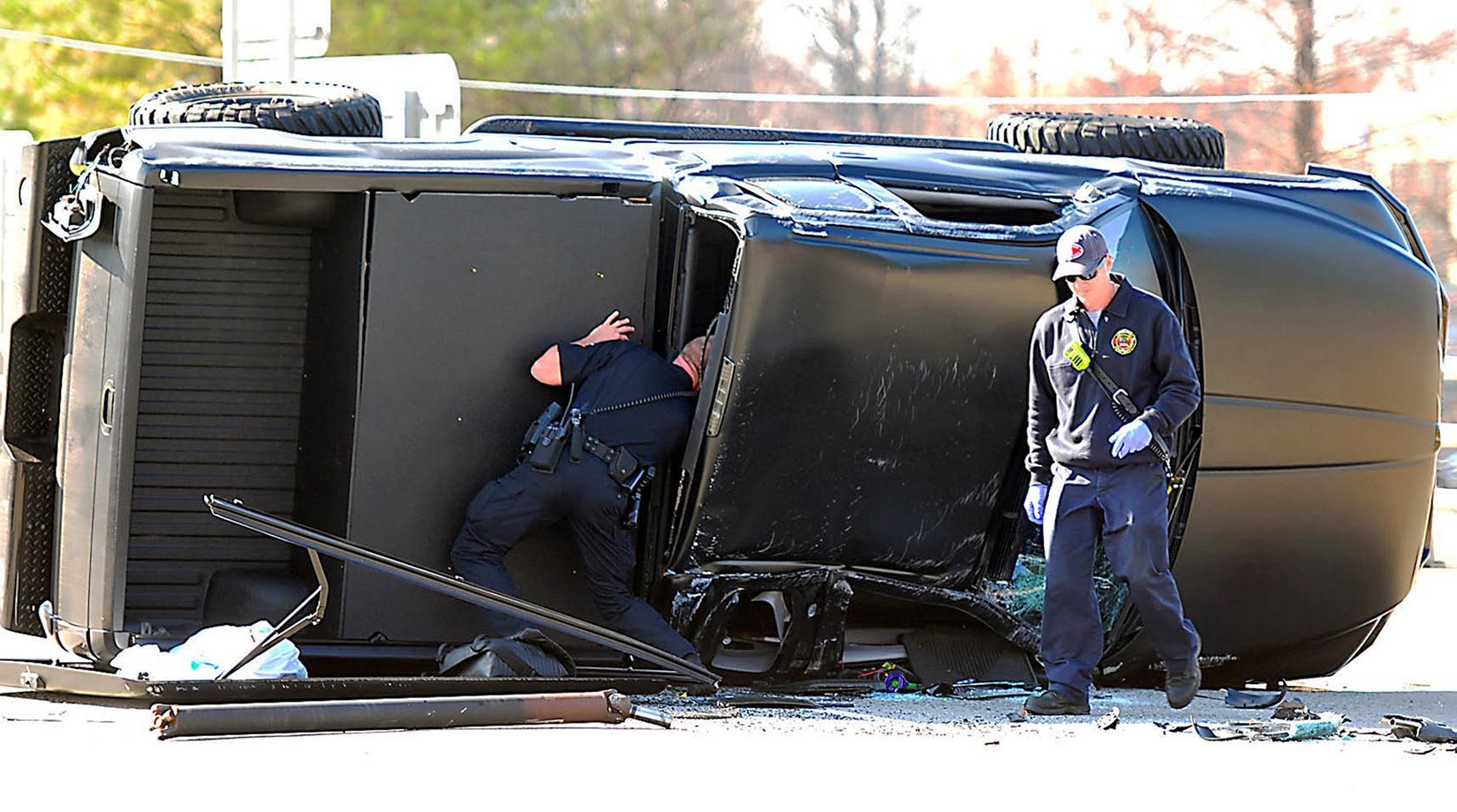 Police and fire officials examine Cam Newton's damaged truck following a Dec. 9, 2014, crash in uptown Charlotte.                                                              Text credit: Daniel Hersh