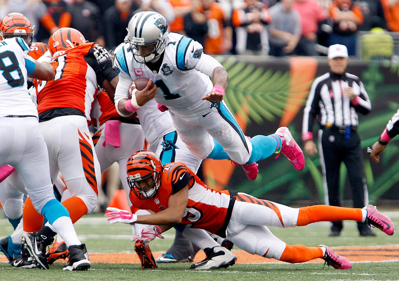 Cam Newton dives for a first down over Cincinnati cornerback Leon Hall during a 37-37 tie at Paul Brown Stadium in Cincinnati in October 2014.                                                               Text credit: Daniel Hersh