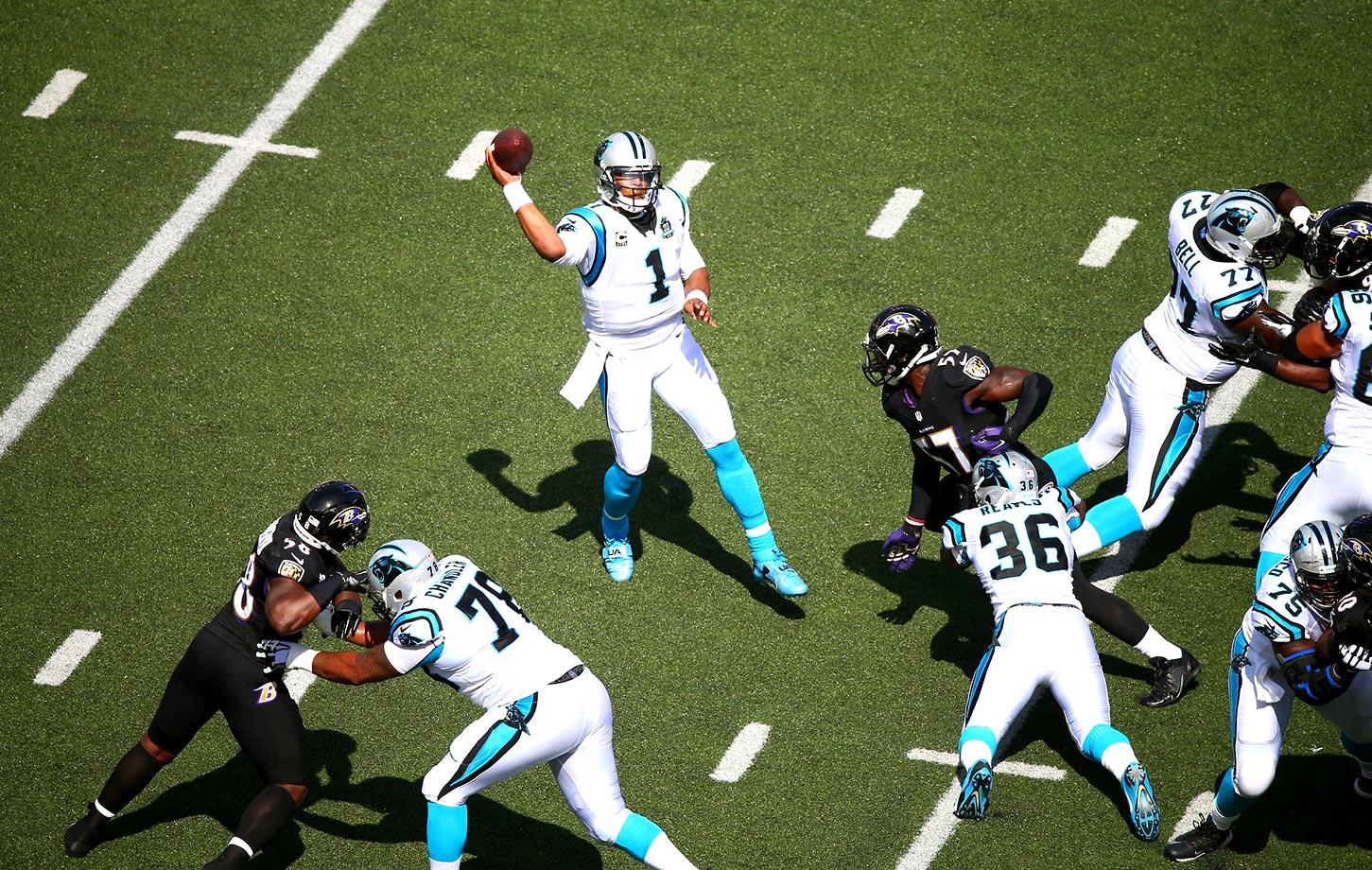 Cam Newton stands in the pocket and throws a pass against the Baltimore Ravens in a September 2014 game. The Ravens won 38-10 as Newton was harassed all game by the defensive front.                                                              Text credit: Daniel Hersh