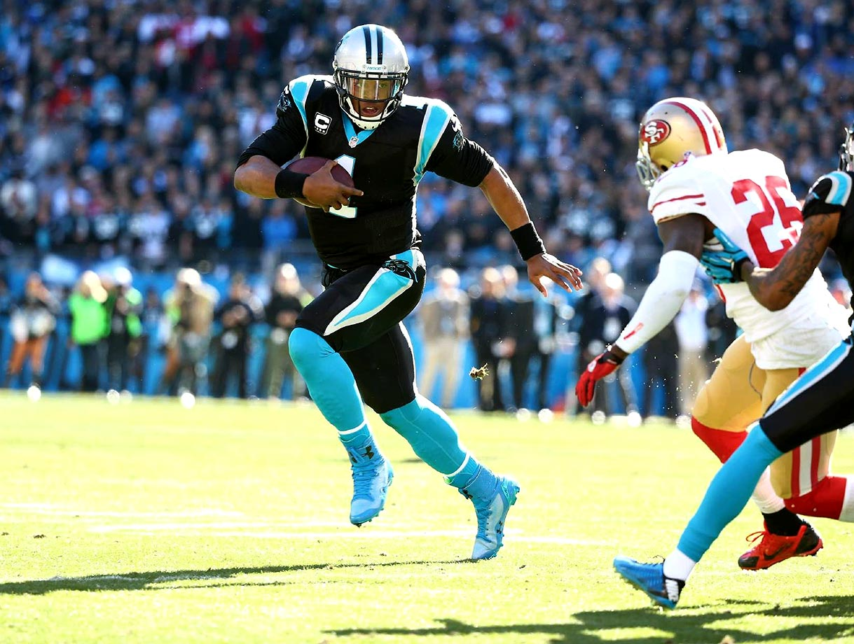 Cam Newton attempts to evade San Francisco 49ers defensive back Tarell Brown during an NFC divisional playoff game. The Panthers lost 23-10.                                                               Text credit: Daniel Hersh