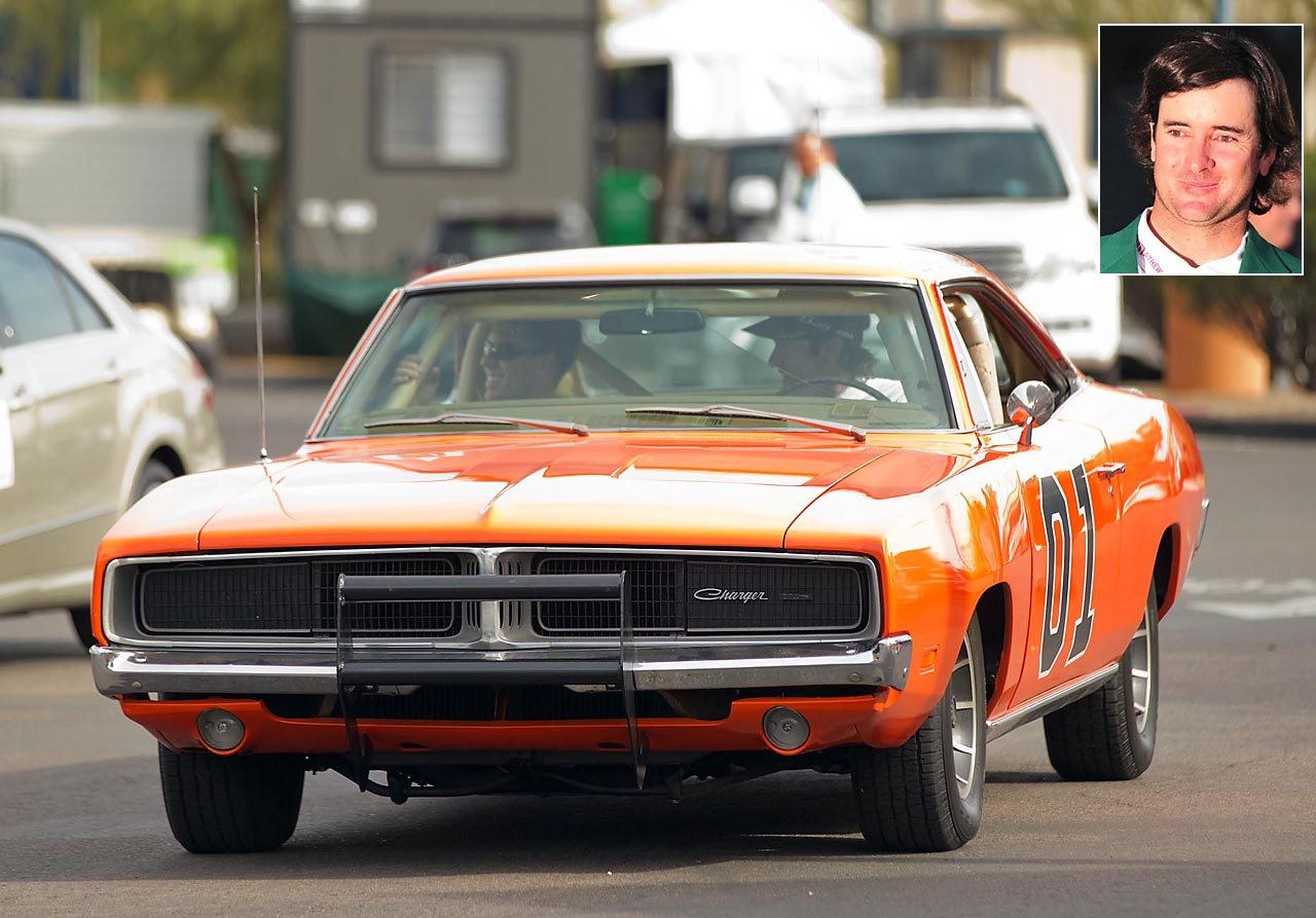 Golfer Bubba Watson behind the wheel in the General Lee, giving a ride to NASCAR Sprint Cup Series driver Carl Edwards.