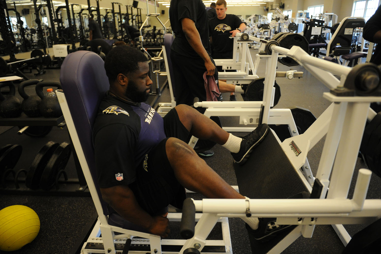 After tearing his ACL in the 2013 BCS Championship against Alabama, rookie defensive end Lewis-Moore will start his professional career on injured reserve. He's pictured here doing some knee strengthening exercises in hopes of getting back in time for the upcoming season.