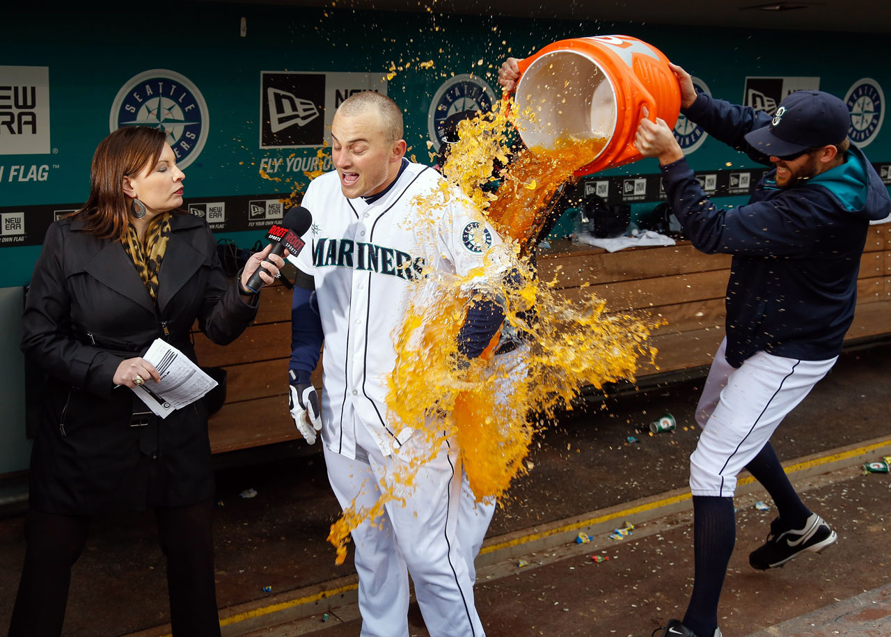 Kyle Seager is doused by teammates after hitting a walk-off home run in the Mariners 5-3 win over the Astros.