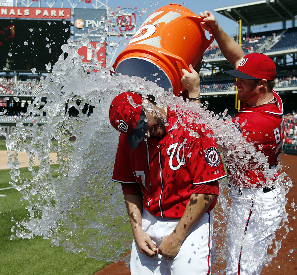 Tanner Roark is doused by teammate Aaron Barrett after pitching a complete game shutout in the Nationals 4-0 over the Padres.