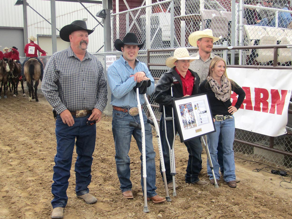 Wyatt poses with (from left), his grandfather Doug Hopes, rodeo star Kaycee Feild, stepdad Boedee Hopes and mother PattiJo Hopes.