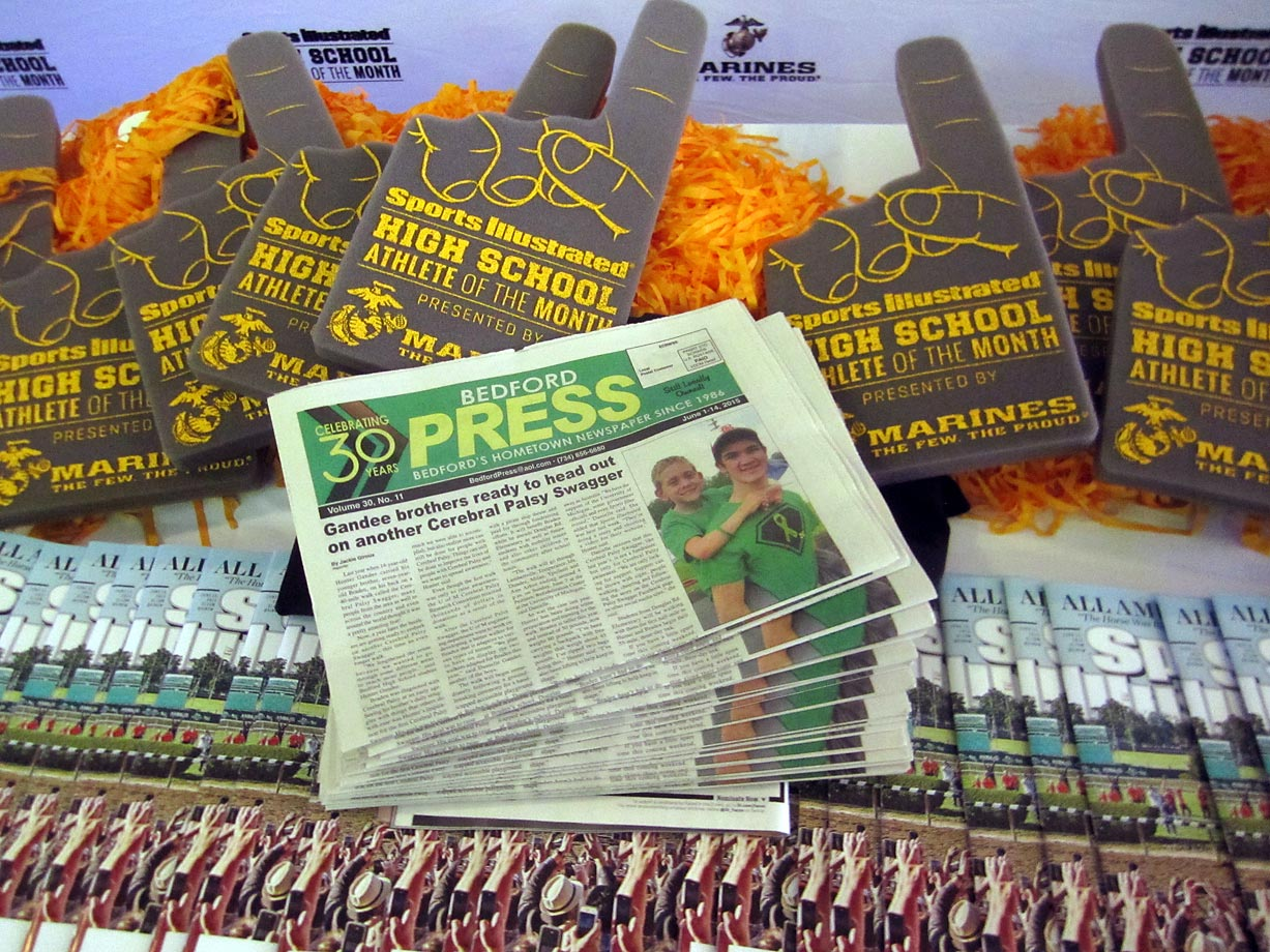 SI was on hand to give out free pom-poms, foam fingers and copies of Sports Illustrated to Bedford High families.