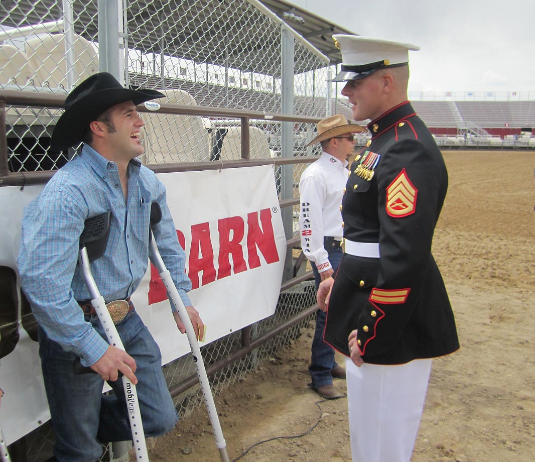 Kaycee Feild and Staff Sgt. Wesley Johnson of the U.S. Marine Corps share a laugh.