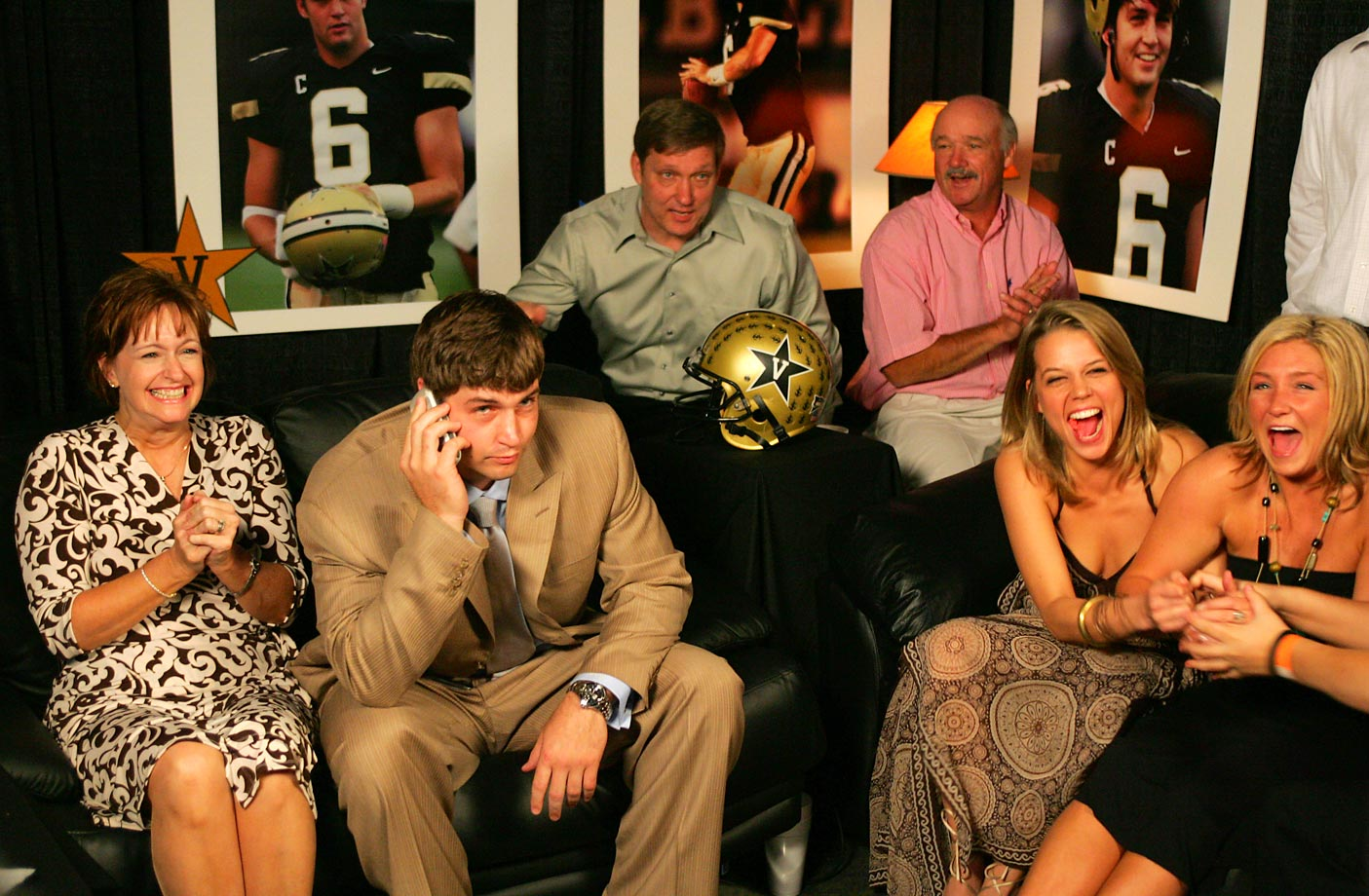 Vanderbilt University quarterback Jay Cutler and his family get the news that he was taken 11th by the Denver Broncos in the 2006 draft. Cutler was at a restaurant celebrating his birthday on the same day.