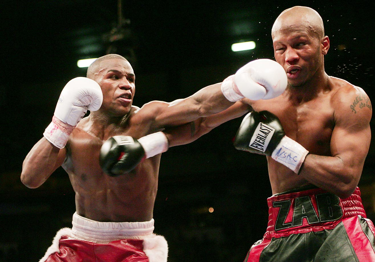 Mayweather survived a spirited challenge from Zab Judah -- along with some low-handed tactics in the 10th round -- on his way to another unanimous-decision victory and the world welterweight championship.
