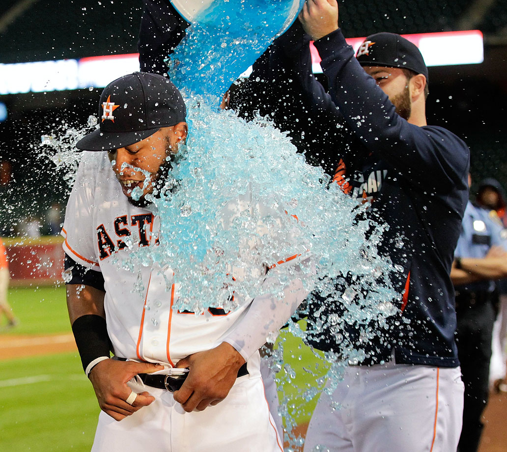 Jon Singleton is doused by teammate Dallas Keuchel after the Astros 7-2 win over the Angels. Singleton's one hit was a solo home run in his major league debut.