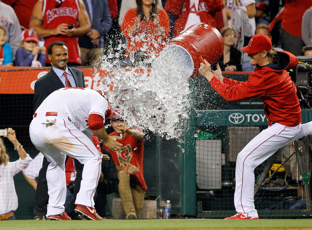 Mike Trout is doused by teammate Jered Weaver following the Angels 6-5 win over the White Sox. Trout hit a game-tying grand slam in the bottom of the eighth inning.