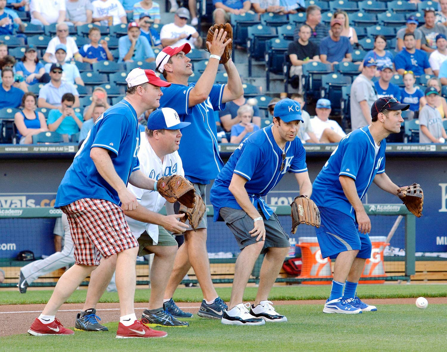 Following the Big Slick Celebrity Classic wiffle ball game, these comedic actors with roots in or around Kansas City caught the ceremonial first pitches of pediatric cancer patients before the Royals game on June 20 at Kauffman Stadium in Kansas City.