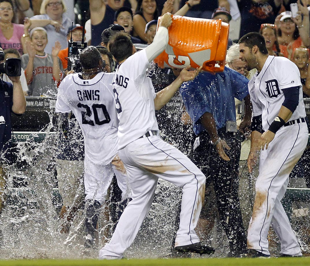 Rajai Davis is doused by teammate Nick Castellanos as J.D. Martinez looks on after Davis hit a walk-off grand slam in the bottom of the ninth inning of the Tigers 5-4 win over the Athletics.