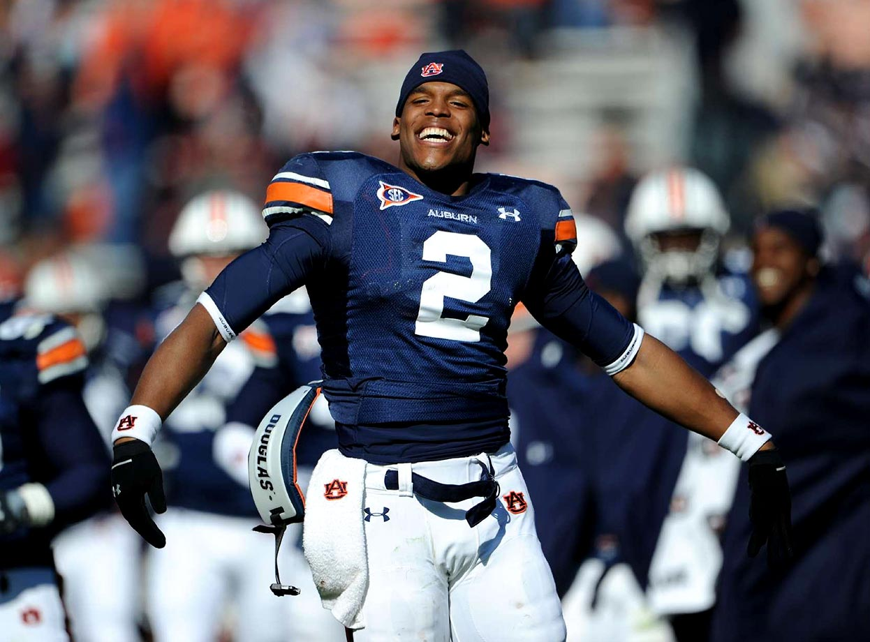 Cam Newton elebrates an October 2010 victory over LSU with Auburn fans. Auburn defeated LSU 24-17 to become the last unbeaten team in the SEC. Text credit: Daniel Hersh