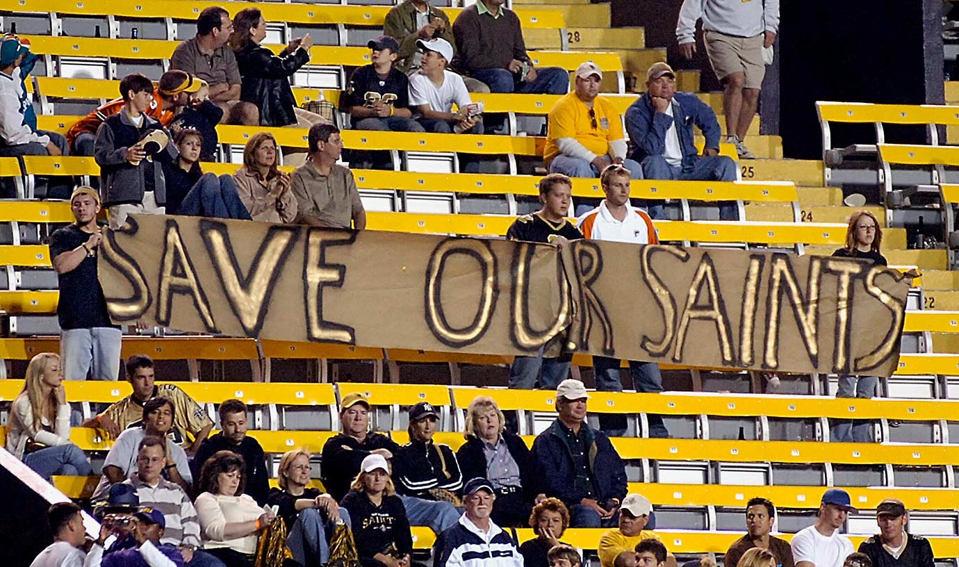 "Oct. 30, 2005: Saints fans unfurl a ""Save Our Saints"" banner in the closing moments of the team's 21-6 loss to the Miami Dolphins at LSU's Tiger Stadium in Baton Rouge, La."