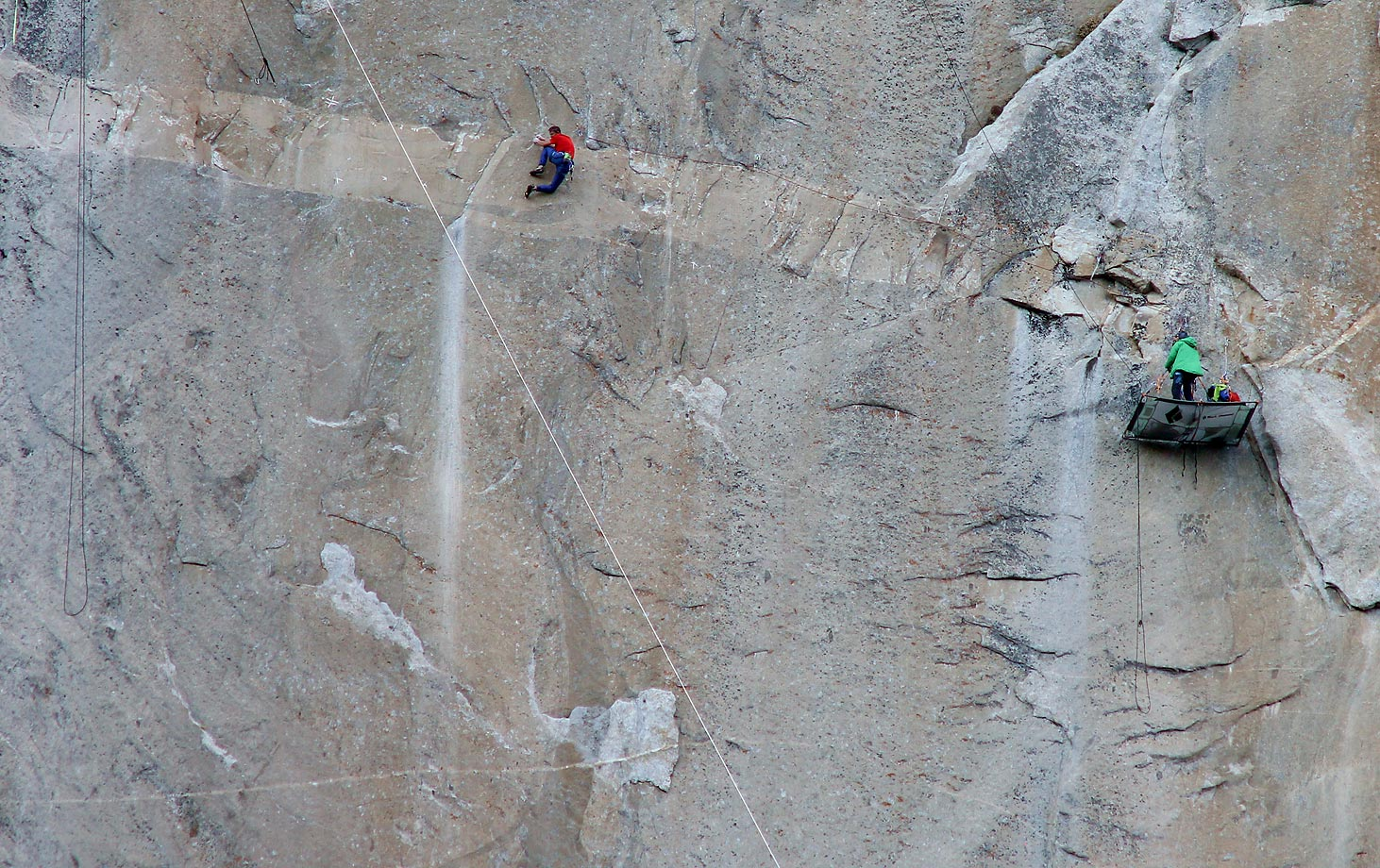 Tommy Caldwell (in red) Climbing on Pitch 14 – Kevin belaying in green.