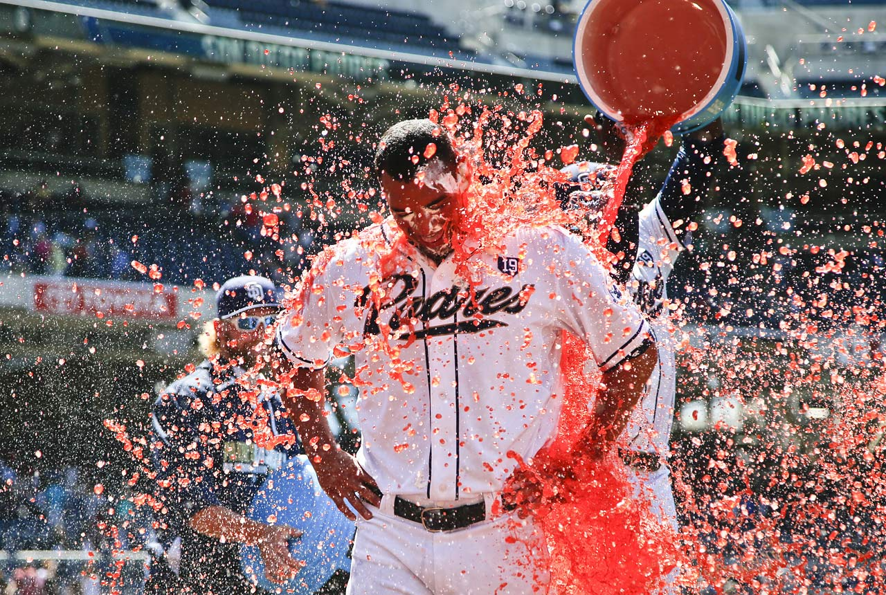 Tyson Ross is doused after pitching a complete game shutout in the Padres 3-0 win over the Reds.