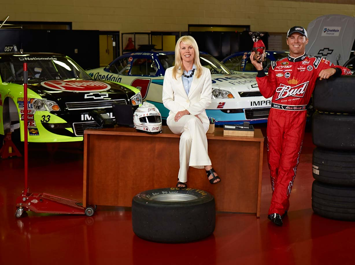 Kevin Harvick and wife Delana and dog Lo at a 2011 photo shoot for SI.