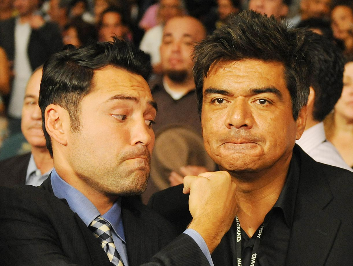 Oscar De La Hoya and comedian George Lopez joke around as Floyd Mayweather prepared to take the ring against Juan Manuel Marquez.