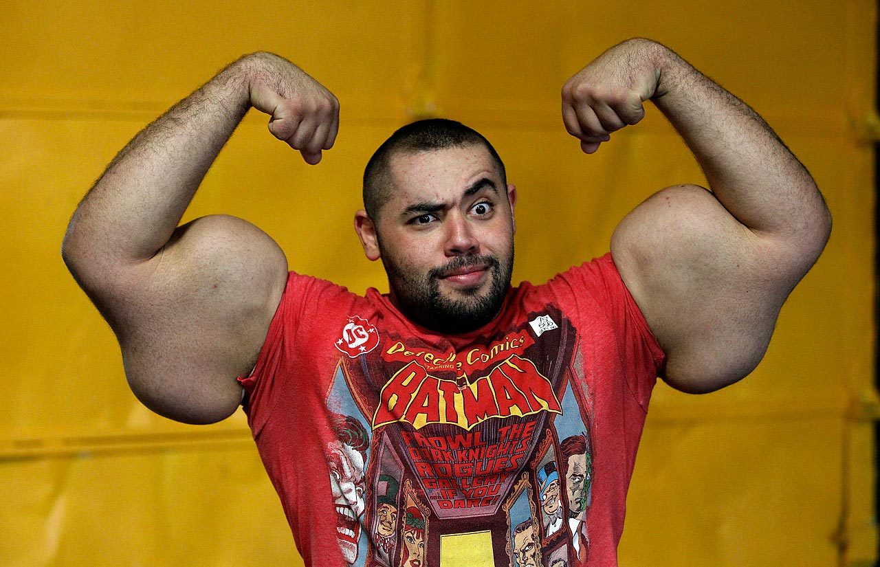 Egyptian Body builder Moustafa Ismail poses during his daily workout at World Gym in Milford, Mass. Ismail has been given the title of world's biggest arms, biceps and triceps by the Guinness Book of World Records.