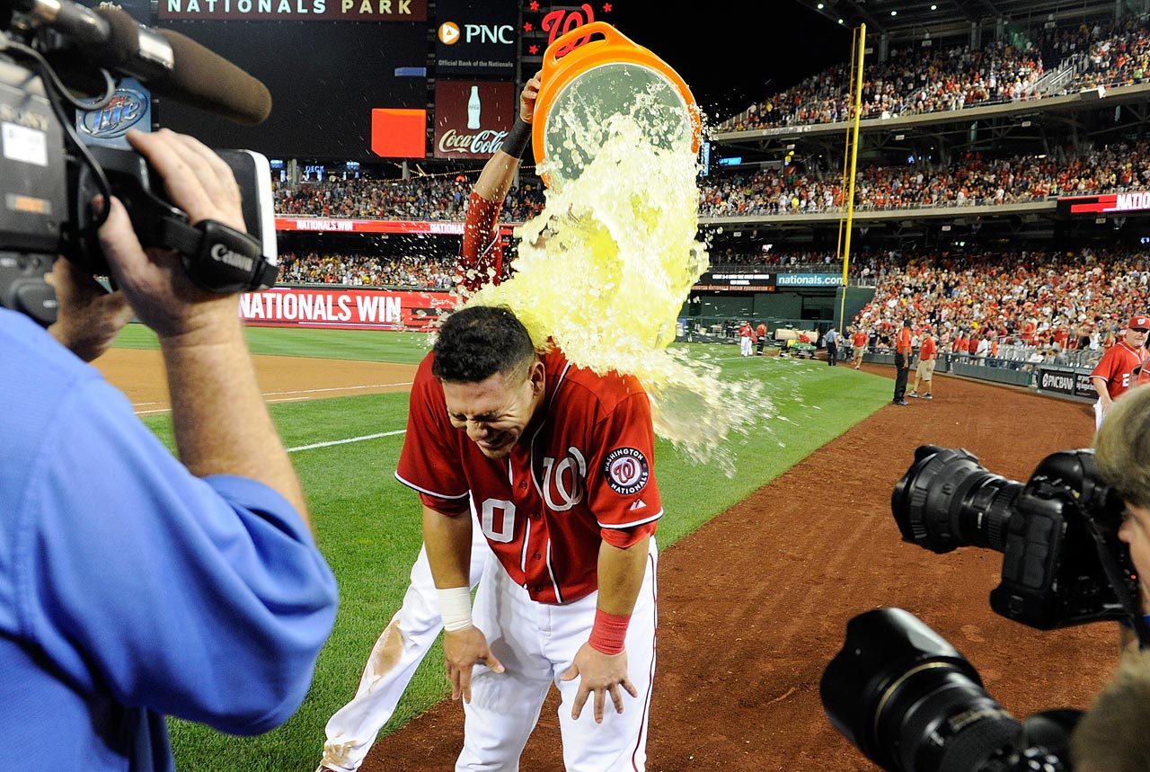 Wilson Ramos is doused with gatorade after driving in the game-winning run in the ninth inning of the Nationals 4-3 win over the Pirates.