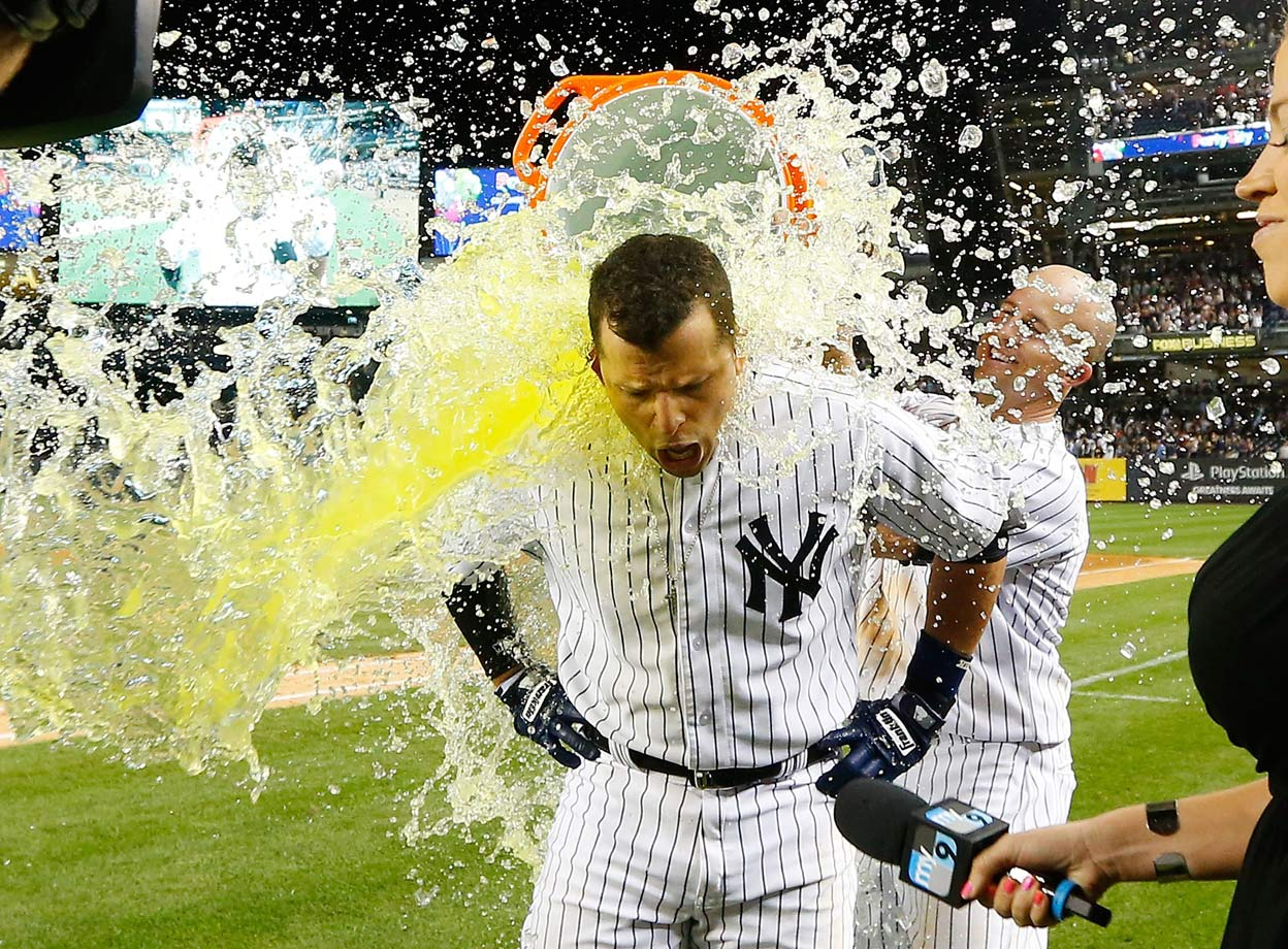 Martin Prado is doused by teammate Brett Gardner after his game-winning hit in the Yankees 4-3 win over the White Sox.