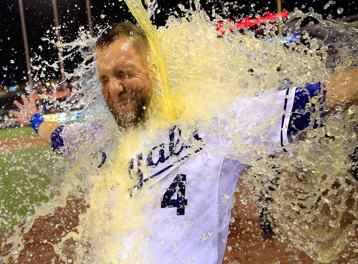 Alex Gordon is doused by teammate Salvador Perez after his game-winning two-run home run in the Royals 2-1 win over the Twins.