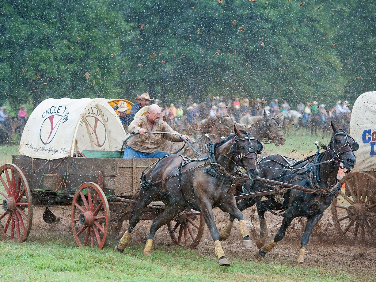 "Races run no matter how hard its raining. Cowboys don't care. Classic Wagon team ""Circle Y Farms"" driver Rusty Young and cook Jeremy Linville fight through the inclimate weather."