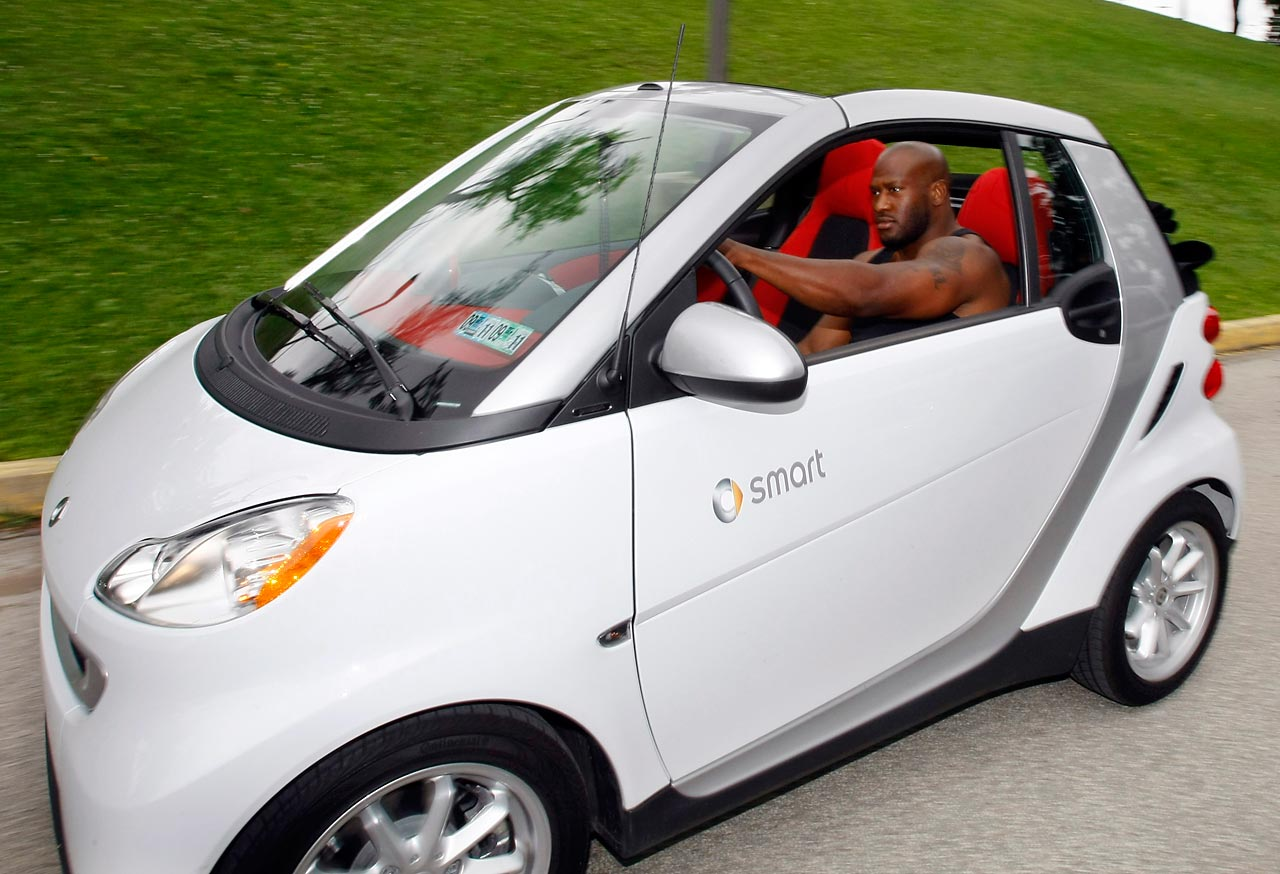 Despite his immense size, NFL linebacker James Harrison drives a subcompact car as he arrives at NFL training camp in Latrobe, Pa. in 2009.