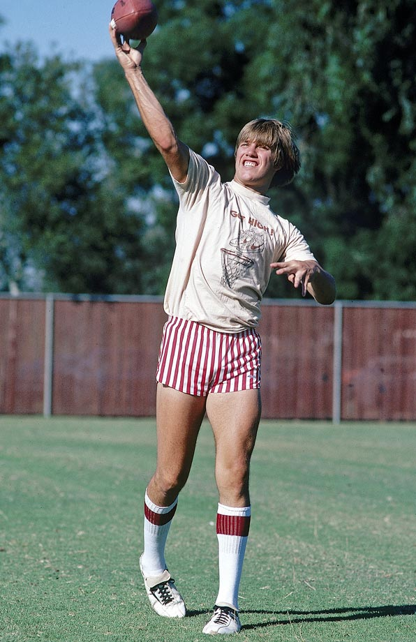 "Anyone wearing red-striped shorts, knee-length tube socks and a T-shirt that says ""Get High"" is going to make a list of 100 funniest photos. The fact that it was Stanford quarterback John Elway makes it that much better."