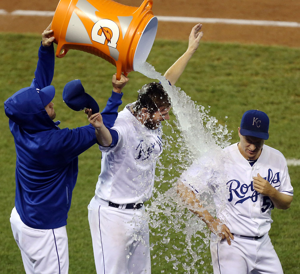 Aaron Crow and Jason Frasor are doused by teammate Danny Duffy after Crow earned the save and Frason got the win in the Royals 2-1 win over the Rangers.
