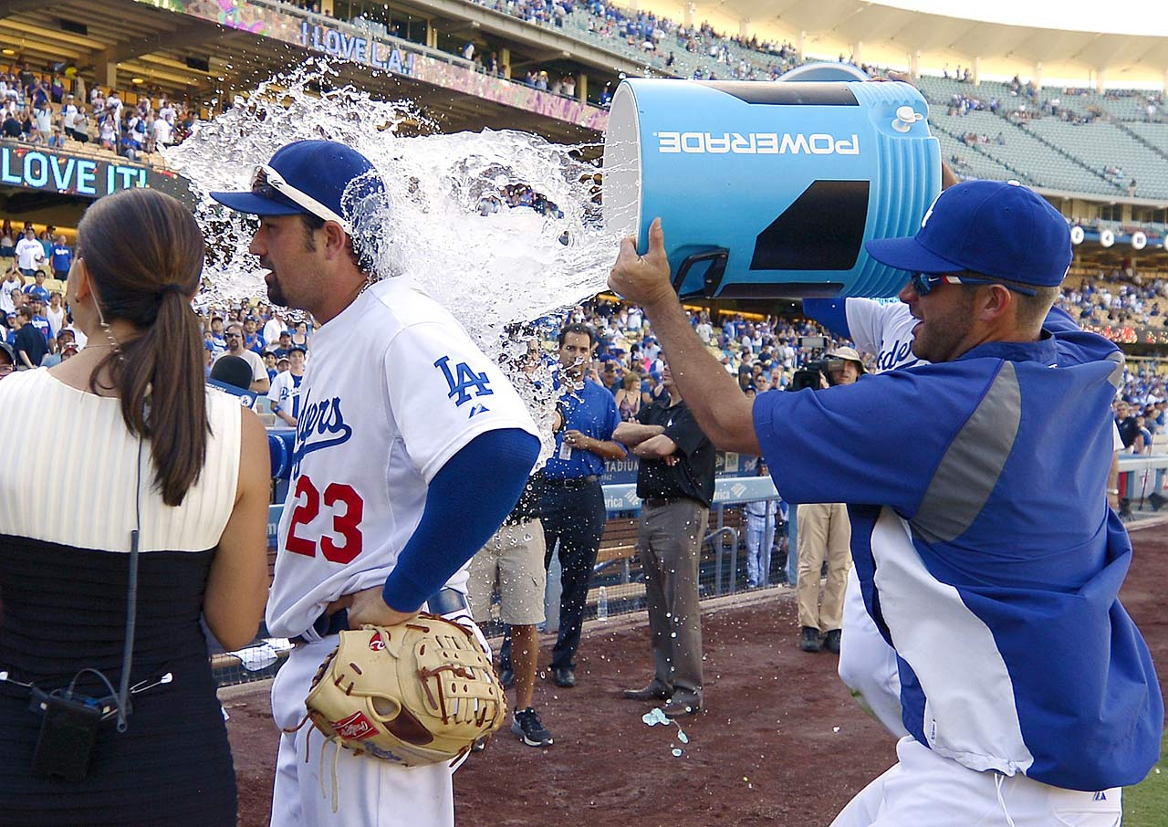 Adrian Gonzalez is doused by teammate Drew Butera following the Dodgers 7-2 win over the Diamondbacks.  Gonzalez hit two three-run home runs in the game.