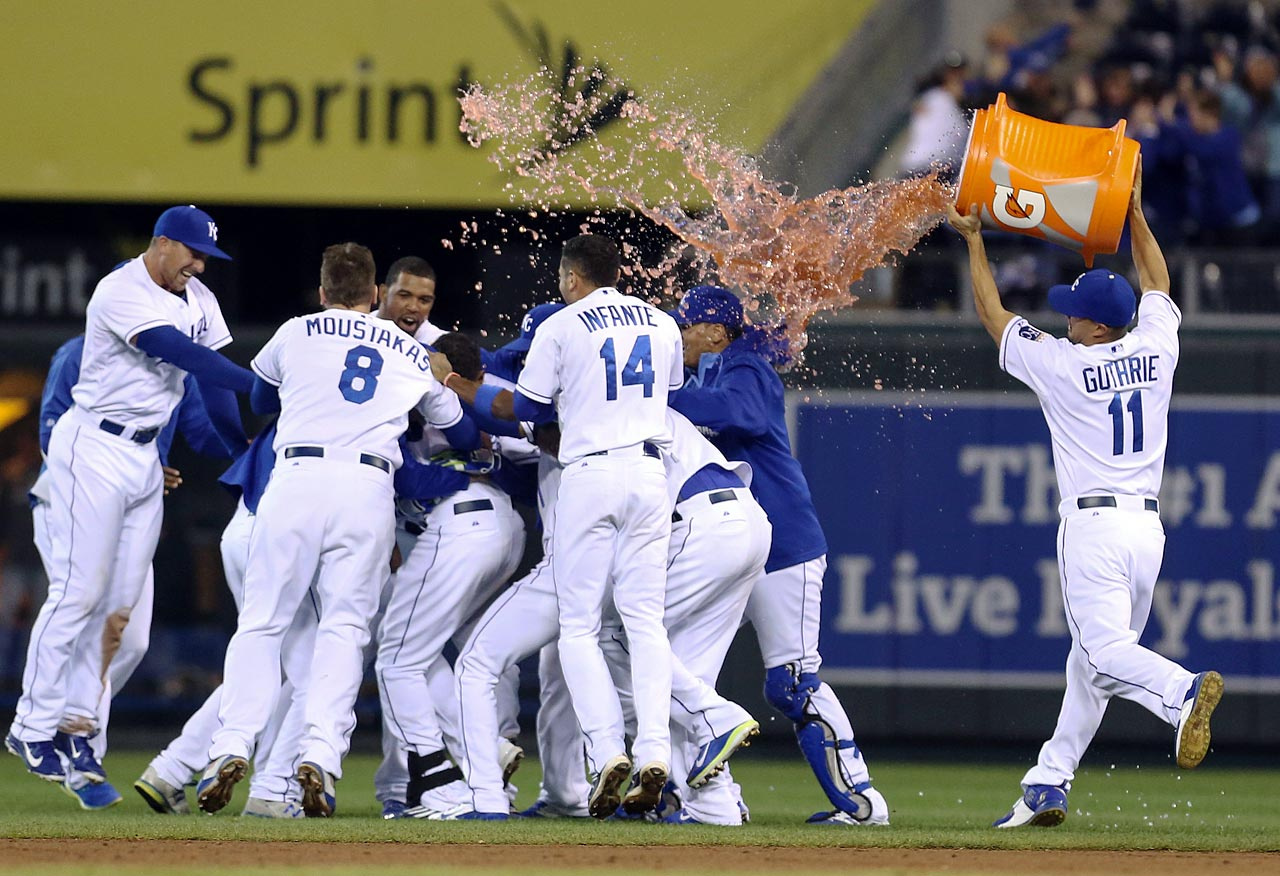 Kansas City Royals players are doused by teammate Jeremy Guthrie after the Royals came back, down three runs, to win 4-3 over the White Sox.