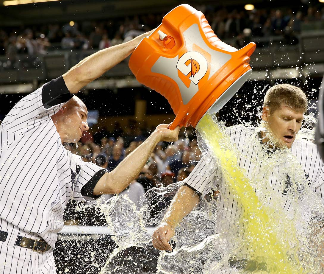 Chase Headley is doused by teammate Brett Gardner after his game-winning RBI in the Yankees 3-2 win over the Blue Jays.