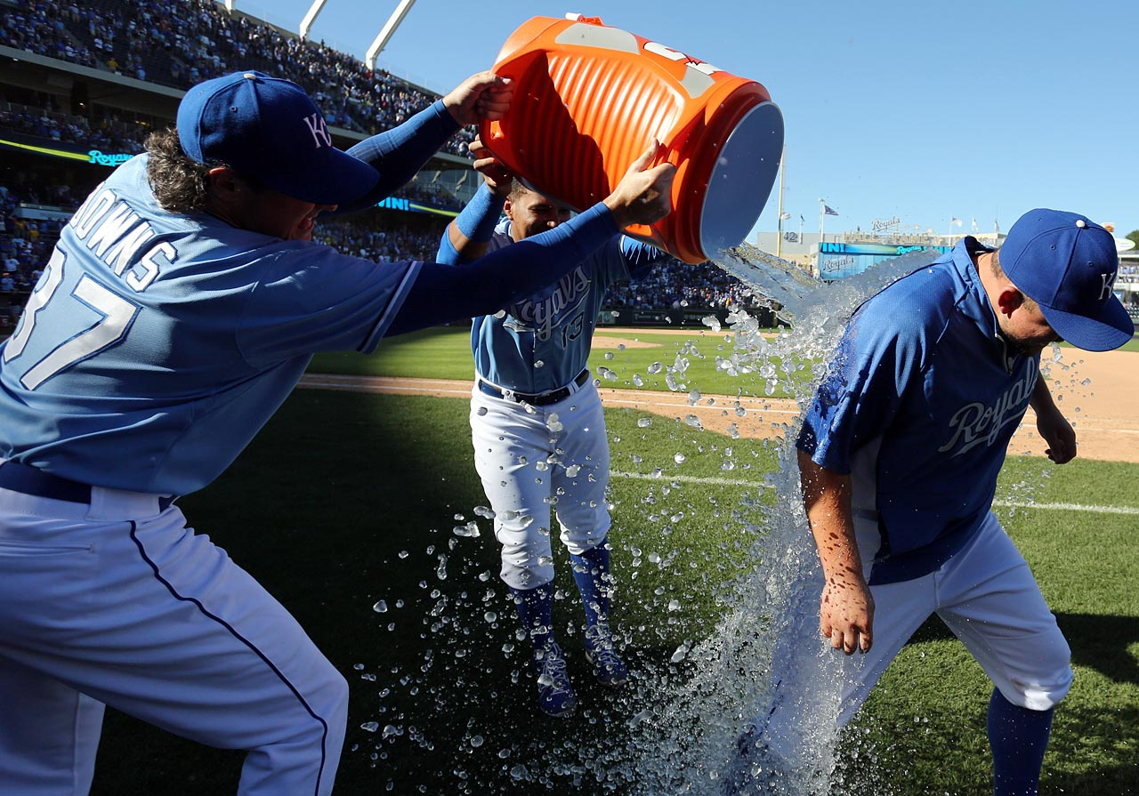 Billy Butler is doused by teammates Scott Downs and Salvador Perez following the Royals 5-2 win over the Tigers.  Butler went 2-for-4 with an RBI in the game.