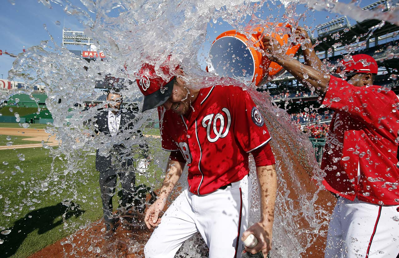 Doug Fister is doused by teammate Michael Taylor after pitching a complete game shutout in the Nationals 4-0 win over the Marlins.