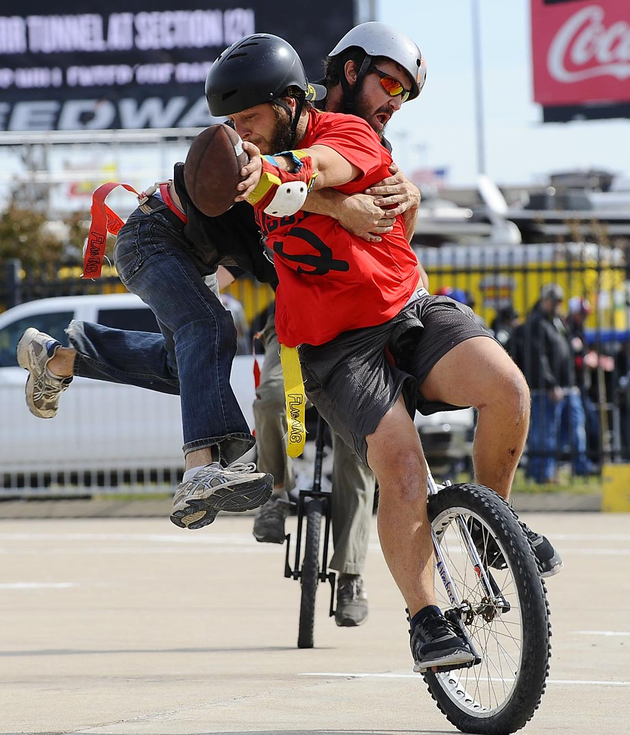 "Chance Whitehead, left, who is known as ""Crazy Horse"" and Dane Walter, aka ""Toilet Face"", in action during a game of unicycle football at Texas Motor Speedway."