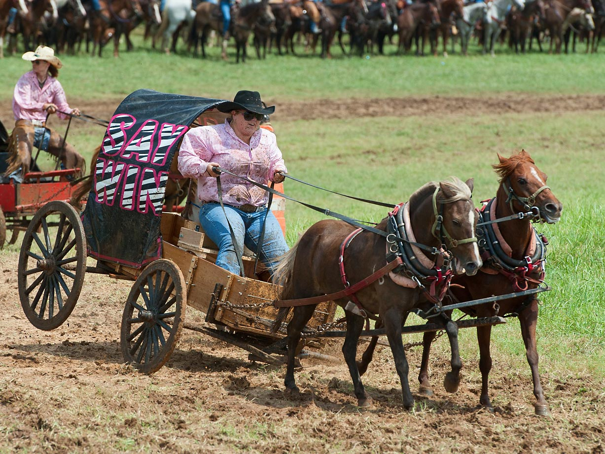 """Courtney Burke of team """"Say Win"""" finishes the Oklahoma Land Rush Division race on 3 wheels."""