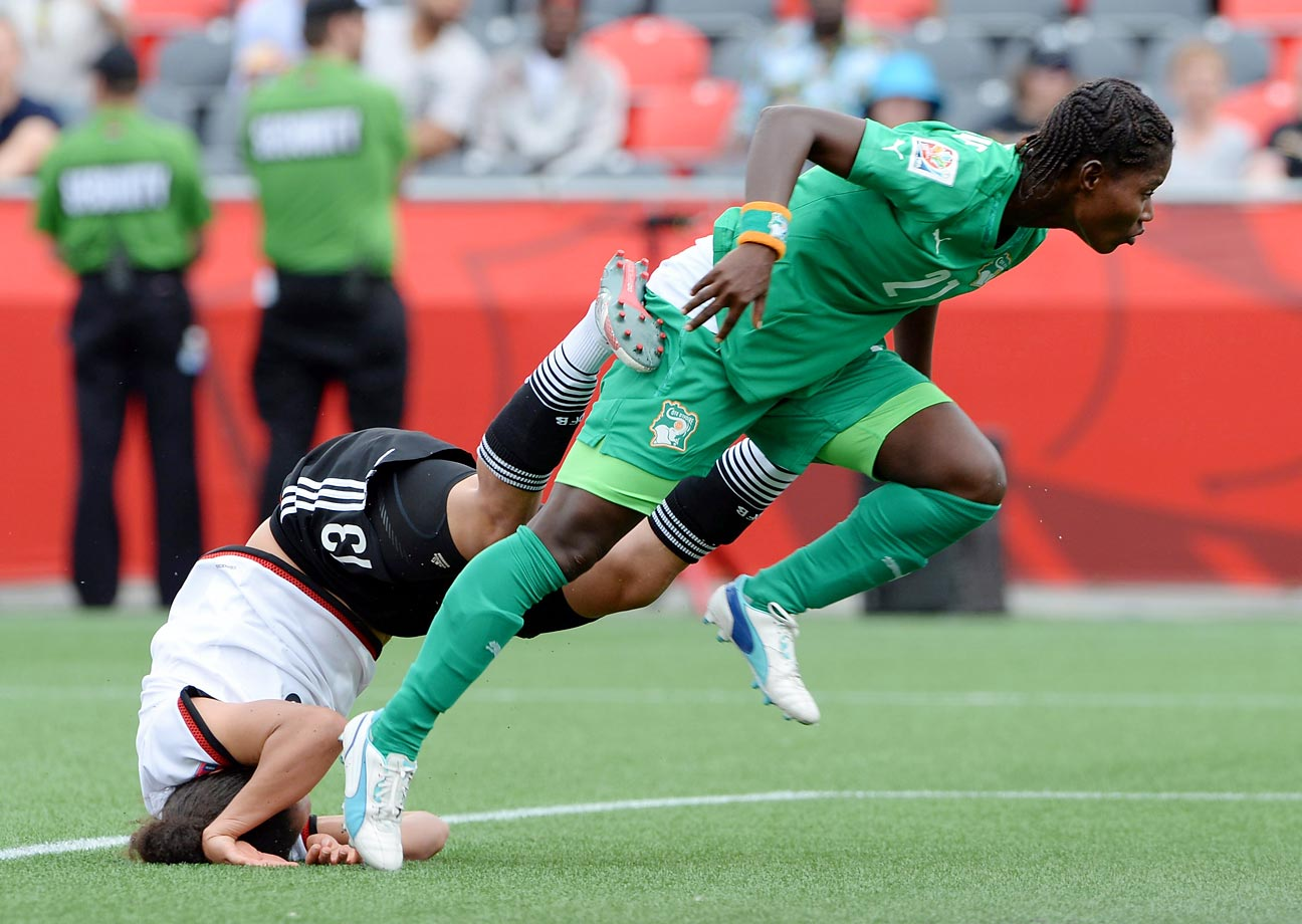 A collision with Ivory Coast's Sophie Aguie sends Germany's Celia Sasic to the turf during the FIFA Women's World Cup in Ottawa, Ontario on June 7.