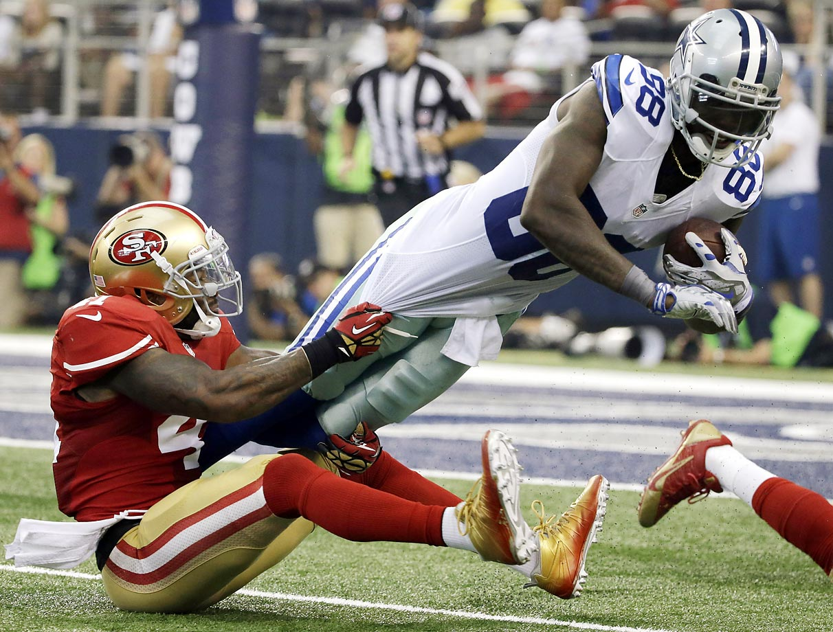 Dallas Cowboys tight end Gavin Escobar is brought down by San Francisco 49ers strong safety Antoine Bethea.